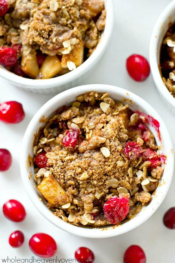 These mini-sized pear cranberry crisps are a breeze to throw together and you won't be able to resist the gooey fruit filling and crisp buttery streusel! No sharing necessary. @WholeHeavenly