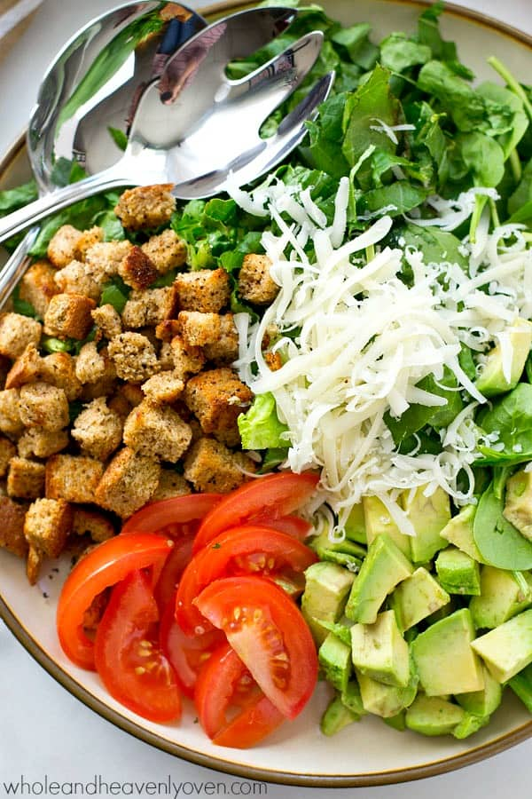 This upscaled caesar salad is loaded to capacity with plenty of greens, fresh avocado, croutons, and an amazingly-creamy lighter buttermilk dressing! Healthy lunch is served.