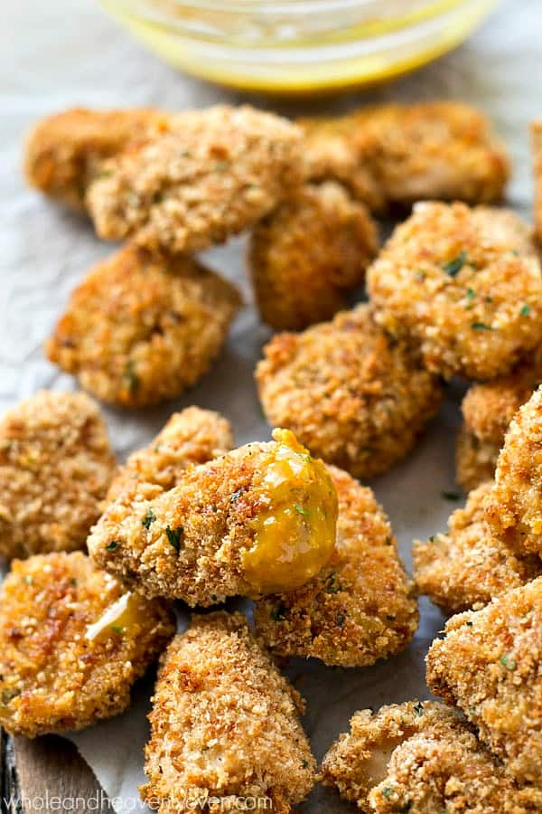 These addicting chicken nuggets are SO extra-crispy on the outside, you won't believe that they're oven-baked! Dip 'em in a tangy honey mustard dip for the best Superbowl appetizer ever.