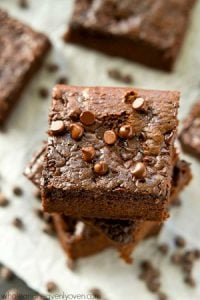 These ultimately-fudgy flourless almond butter brownies are nearly impossible to stop eating! They whip up easily in one bowl and each brownie only contains 125 calories!