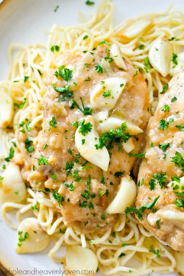Crockpot chicken breasts cook for hours in an ultra-flavorful garlic sauce that's amazing over hot pasta or rice! Just throw everything in the crockpot and forget about dinner.