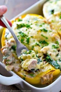 Enjoy chicken alfredo lightened-up in these cheesy spinach-loaded spaghetti squash boats!