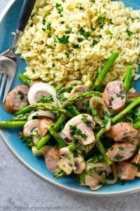 One skillet and a handful of basic ingredients is all you'll need to make this spring-loaded sausage veggie skillet dinner! It's absolutely out of this world with hot rice.