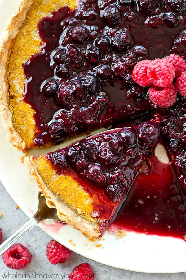 A luscious and beautiful lemon tart that is SUPER-easy to make and covered in a tangy mixed berry citrus sauce!---The perfect springtime dessert.