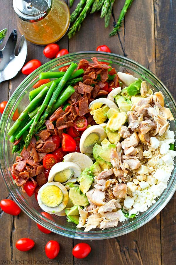 This spring-themed cobb salad will put all other lunch salads to shame! Loaded to the brim with spring goodness and drizzled with an INSANE red wine dressing!