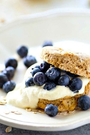 Tender and buttery oat-packed biscuits are filled with tons of zingy lemon whipped cream and piled high with beautiful fresh blueberries for a simple, yet stunning summer dessert.