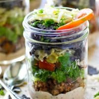 Eat your taco salad the fun and EASY way in these colorful layered salads.---The chipotle ranch dressing kicks all the flavors up a notch!
