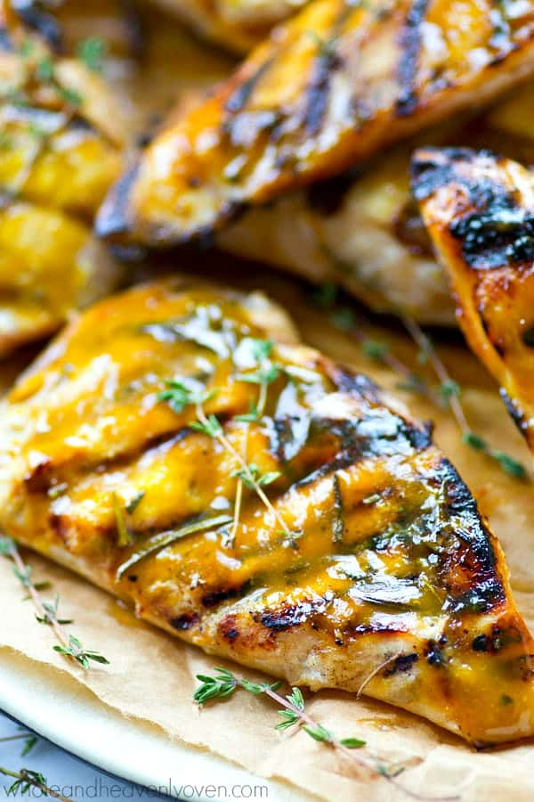 Marinated for hours in a sweet 'n' tangy homemade honey mustard and then grilled to smoky perfection, these honey mustard chicken cutlets will quickly become a summer grilling favorite!