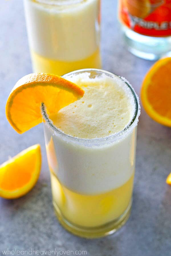 Creamy, citrus-y and perfectly frosty, these cocktail slushies are like an orange creamsicle in boozy adult form!---The perfect summer cocktail.