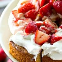 Classic summertime strawberry shortcake is made EASY in this single-layer yellow cake that's piled high with fluffy whipped cream and lots of fresh strawberry sauce!