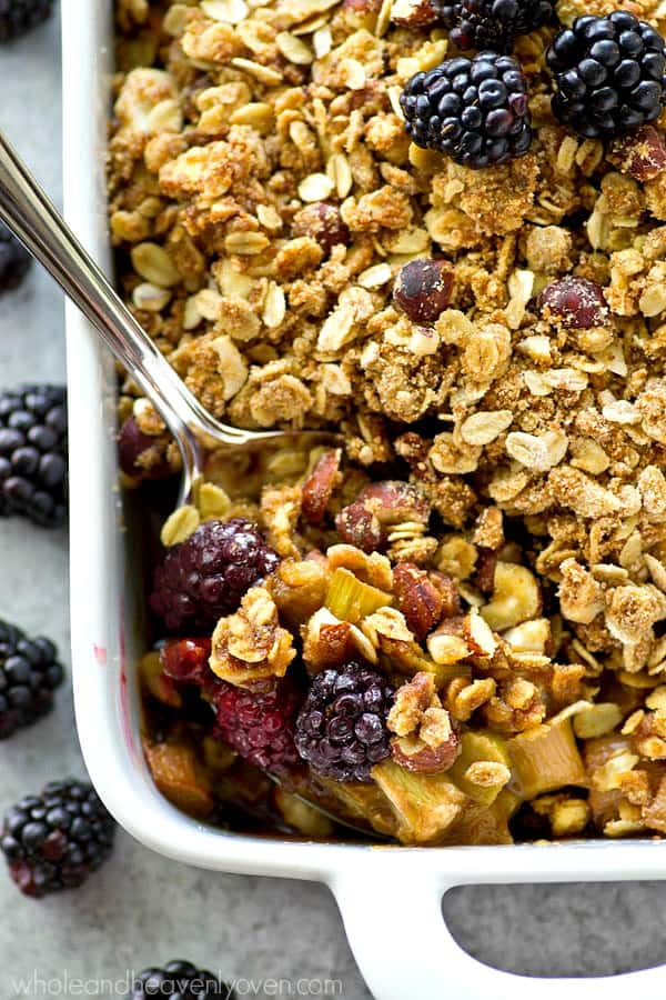 Juicy blackberries and tangy rhubarb are a match made in heaven together in this summery crumble that's piled high with a buttery almond streusel topping.---Don't forget the whipped cream on top!