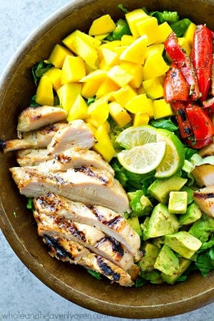 Hawaiian-style grilled chicken, sweet mango, and a tangy citrus dressing bring out all the BEST fresh flavors in this gorgeous summer salad! It's almost too pretty to eat.