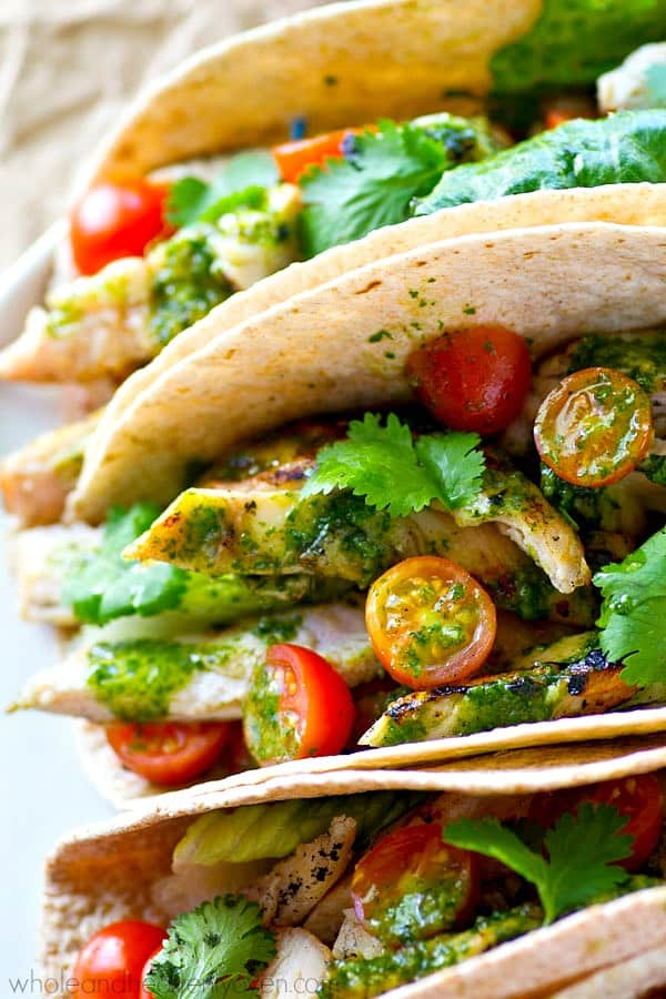A flavorful greek marinade and plenty of zesty homemade chimichurri sauce take these grilled chicken tacos over the top in summer flavors! These tacos are so easy, they'll have a permanent spot on your dinner menu!