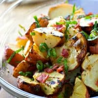 Smoky grilled red potatoes, crisp bacon bits, and a flavorful basil vinaigrette make the ultimate summertime potato salad that's a perfect lighter alternative to mayonnaise-dressed salads!