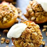 Juicy, sweet summer peaches are stuffed with a cinnamon sugary oatmeal pecan streusel filling and topped with lots of fresh whipped cream for an ultimately easy summer dessert!