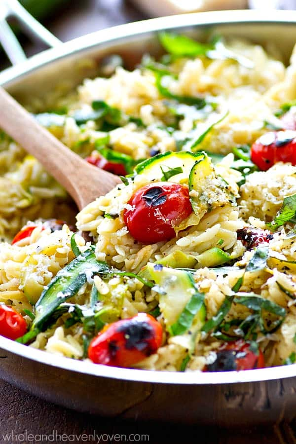 This healthy veggie-loaded orzo skillet is a veggie-lover's dream! Ready in less than 30 minutes and perfect for a quick summer weekday dinner or lunch!