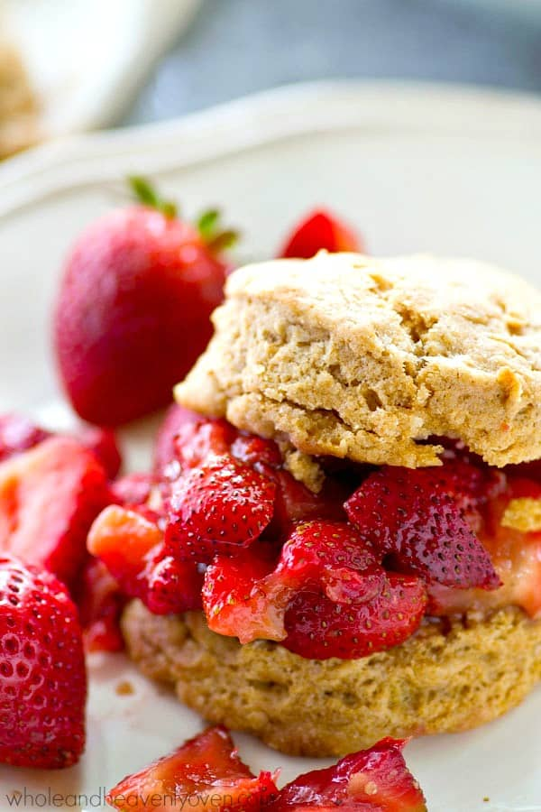 Extra-flaky coconut oil biscuits and an insanely-fresh strawberry sauce are a match made in mid-summer heaven! Serve these summery biscuits for breakfast OR dessert!