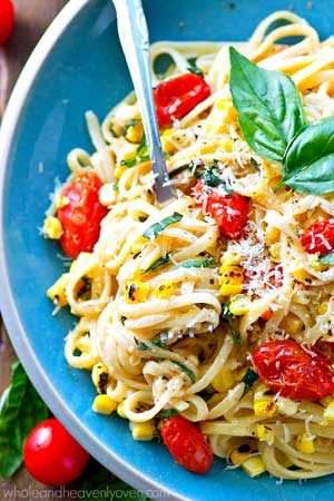 Creamy, comforting fettuccine alfredo meets summer! These luscious noodles are piled high with bursting cherry tomatoes, charred corn, and plenty of fresh Parmesan cheese.