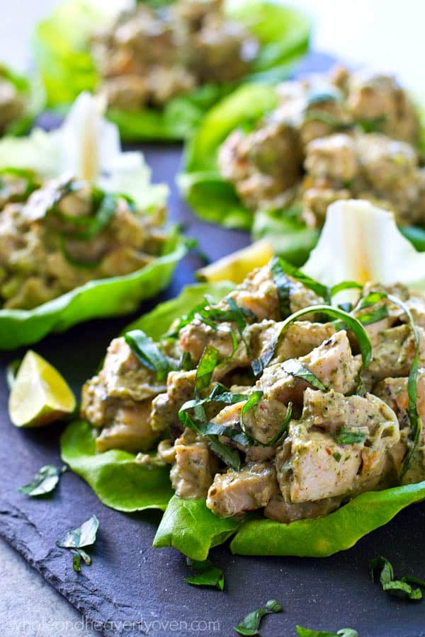 Chicken salad gets a fun summer reboot by using juicy grilled chicken and lots of flavorful pesto all wrapped up in a pretty AND healthy lunch lettuce wrap!