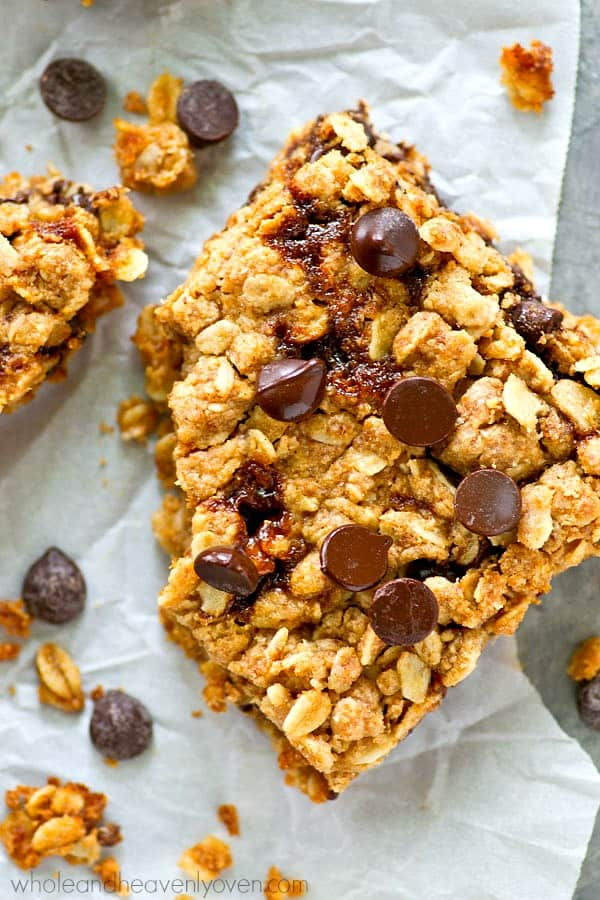 Packed with peanut butter, chocolate, oats, and homemade caramel sauce, these coconut oil oat bars literally have it all!---Perfect for an after-school snack or for tucking into lunchboxes.