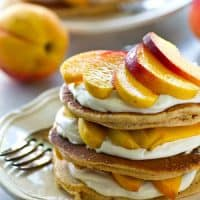 Layered with fluffy pancakes, tangy cream cheese, and lots of fresh juicy peaches, these pancake stacks are easy to throw together and so perfect for summer brunching.