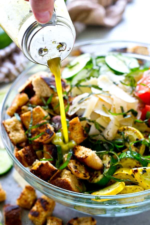 Overflowing with those garden veggies? You've GOT to try this incredible grilled panzanella salad that's loaded with a rainbow of veggies, tons of grilled croutons, and an herby vinaigrette.