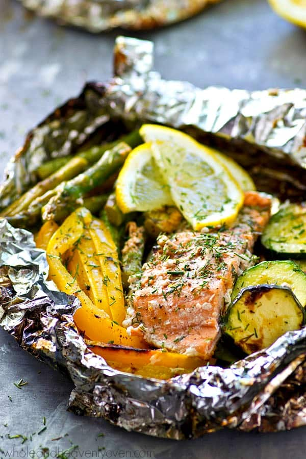 These grilled salmon veggie packets are an entire summer meal-in-one that's ready in under 20 minutes with only a few simple ingredients! Feel free to use your favorite summer veggies.