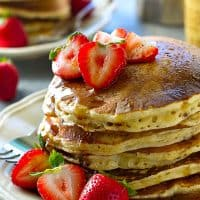 These super-fluffy power pancakes are packed with a huge punch of healthy protein and are insanely amazing with a warm chai spice maple syrup drizzled on top!
