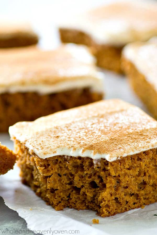 This soft applesauce snack cake gets mixed up in minutes and it bakes up perfectly every time! Smother this cake in tangy cream cheese frosting for one winner fall snack or dessert.