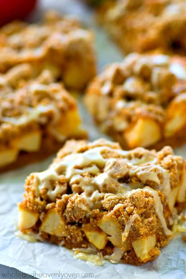 Get your apple pie fix the easy way in these glazed crumb bars that are packed to the max with tender spiced apples, buttery crumb topping, and tons of vanilla glaze on top!