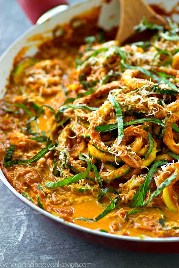 These easy one-pan zucchini noodles are covered in the most AMAZING flavorful sun-dried tomato alfredo sauce and you won't believe they're ready for the dinner table in only 20 minutes!
