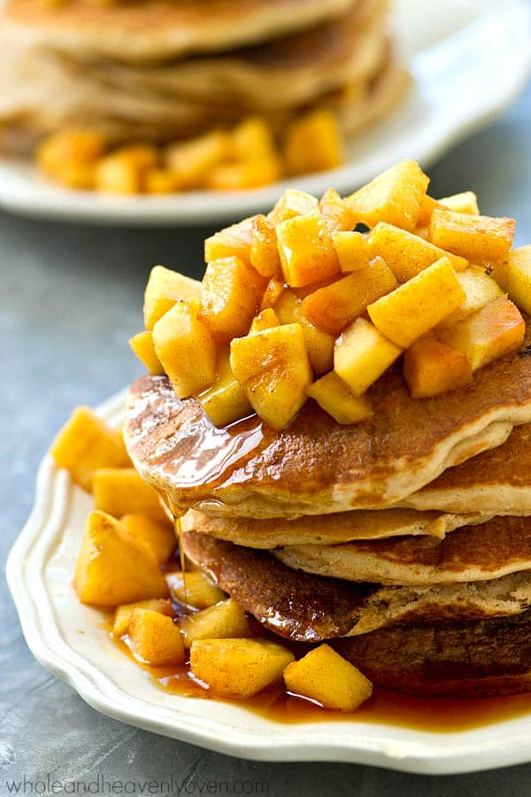 Piled high with a caramelized apple pie topping, these thick and fluffy protein pancakes are the ultimate fall breakfast that you will immediately fall in love with!---It's like eating pie for breakfast.