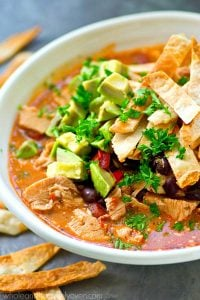 Made completely in the crockpot and unbelievably cozy and comforting, this chicken enchilada soup is so amazing you would NEVER guess it's lighter on the calories!