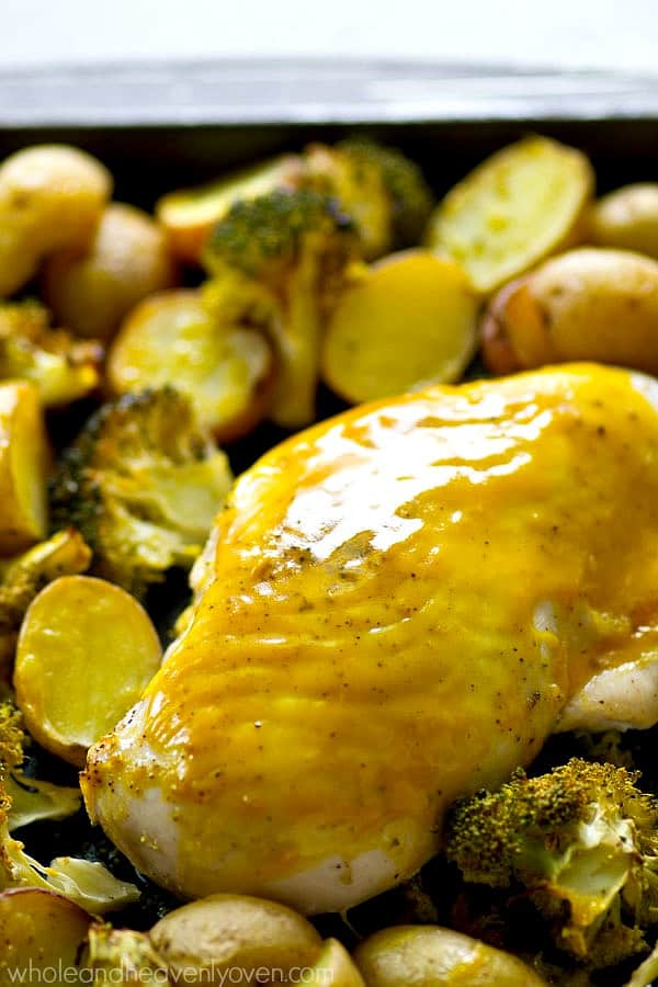 One pan, 6 ingredients, and 40 minutes is all you're going to need to make this flavorful honey mustard chicken that roasts to perfection with tons of broccoli and little fingerling potatoes.