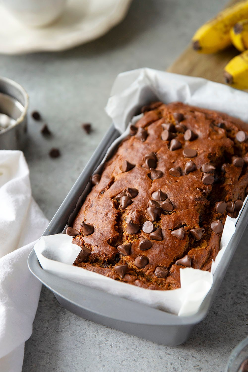 Pumpkin bread and banana bread collide with plenty of chocolate in this banana chocolate chip pumpkin bread that's sure to become a fall favorite!