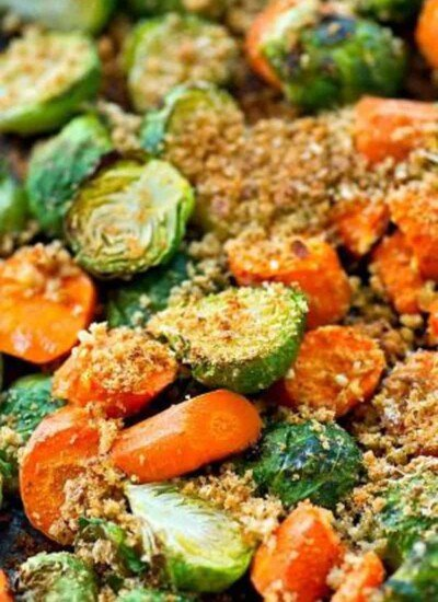 Perfect for an easier Thanksgiving side dish, these roasted Brussels sprouts and carrots are covered in a flavorful Parmesan panko topping - seriously the only way you'll want to eat your vegetables!