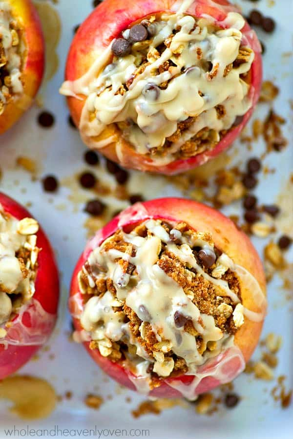 Baked apples are stuffed with a decadent oatmeal chocolate chip cookie filling and drizzled with tons of icing for one killer fall dessert you won't be able to resist!