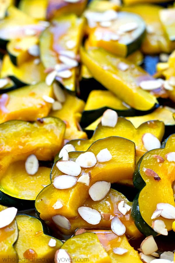 Roasted until perfectly tender and then glazed with a tangy maple citrus glaze, this roasted acorn squash is an insanely-easy holiday side that's pretty to look at and even better tasting!