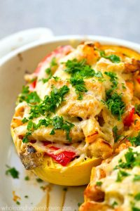 All the things you love about chicken fajitas stuffed into huge cheese-covered spaghetti squash boats! An entire dinner-in-one that's incredibly easy to throw together too.