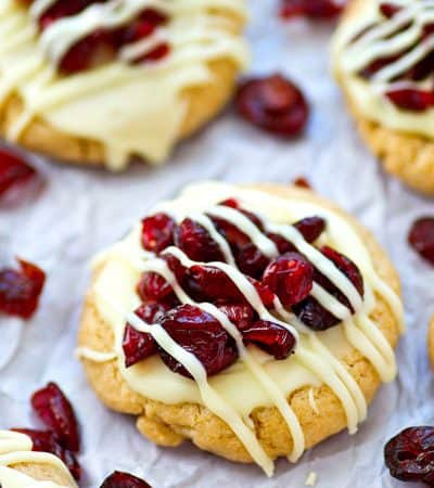 Love the cranberry bliss bars from Starbucks? You've GOT to try them in festive sugar cookie form! You won't believe how easy these little cookie gems are to make.