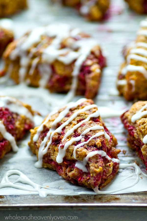 Set these mini raspberry-studded eggnog scones out on any holiday brunch table and watch them disappear! Eggnog in both the dough and the glaze makes them unbelievably rich and flaky.