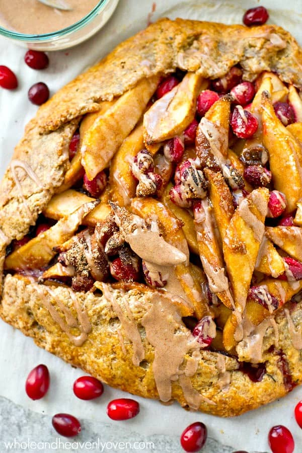 Forget about that fussy pie. This chai spice-glazed pear cranberry galette is so unbelievably easy to throw together and such a pretty holiday dessert!