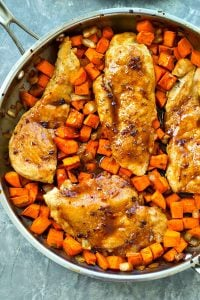 These flavorful skillet chicken breasts bake up in only one pan with an incredible sweet potato hash and an insanely-good maple glaze.--- This 30-minute skillet dinner is a weeknight keeper!