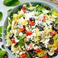 Greek salad gets a fun makeover with the addition of spaghetti squash and an incredible lemon-y garlic vinaigrette. This easy spaghetti squash salad is practically a meal in itself!