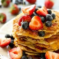 Unbelievably soft and fluffy inside and loaded with a double-whammy of juicy berries, these multi-grain pancakes are super easy to whip up and only 225 calories per two pancakes!