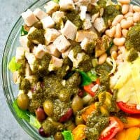 This Tuscan-style turkey salad is loaded with so much fresh healthy goodness and a simple pesto vinaigrette adds an unbelievable amount of flavor!