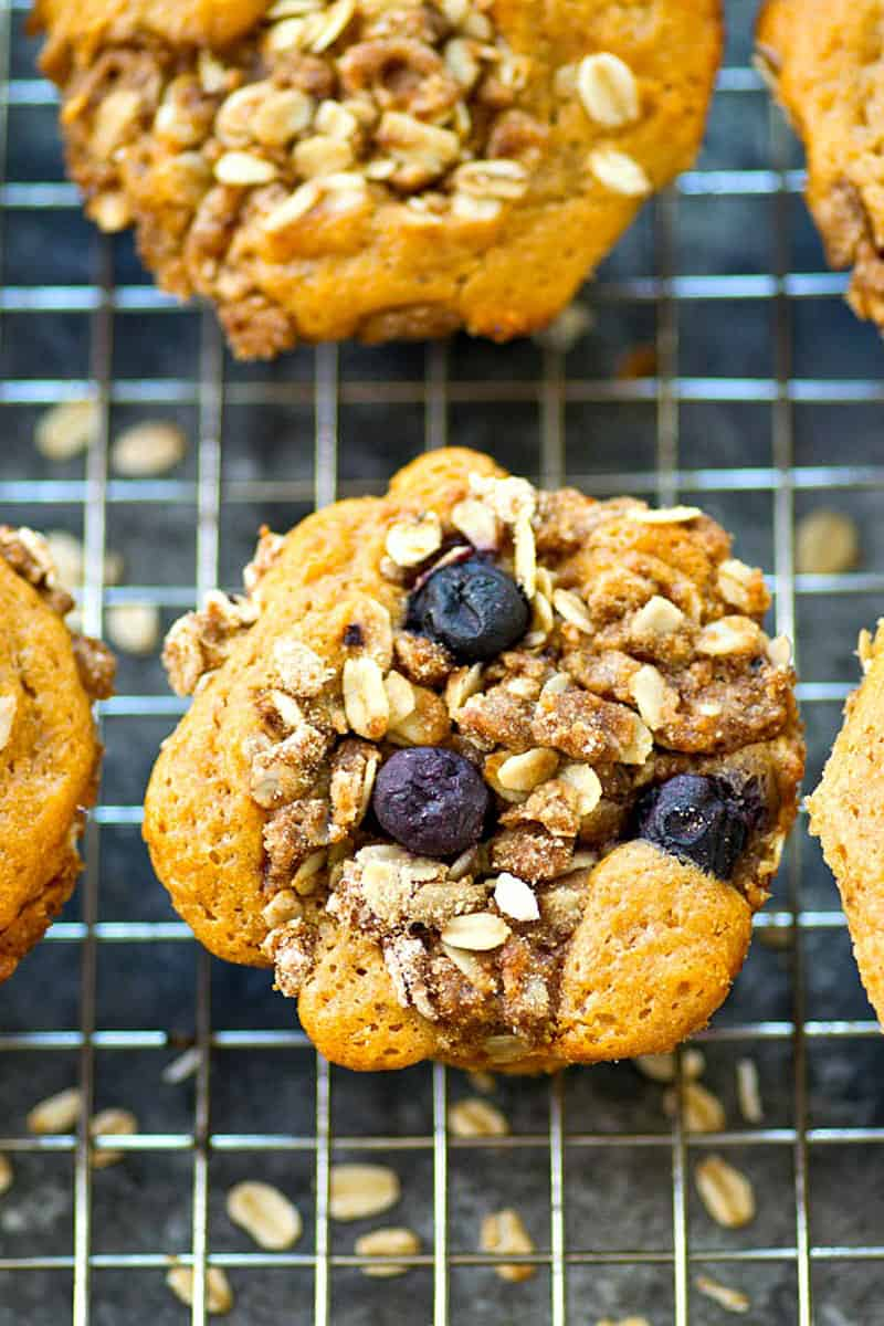 Piled high with oatmeal streusel and packed with juicy blueberries, these super-moist blueberry sour cream muffins are better than any bakery!