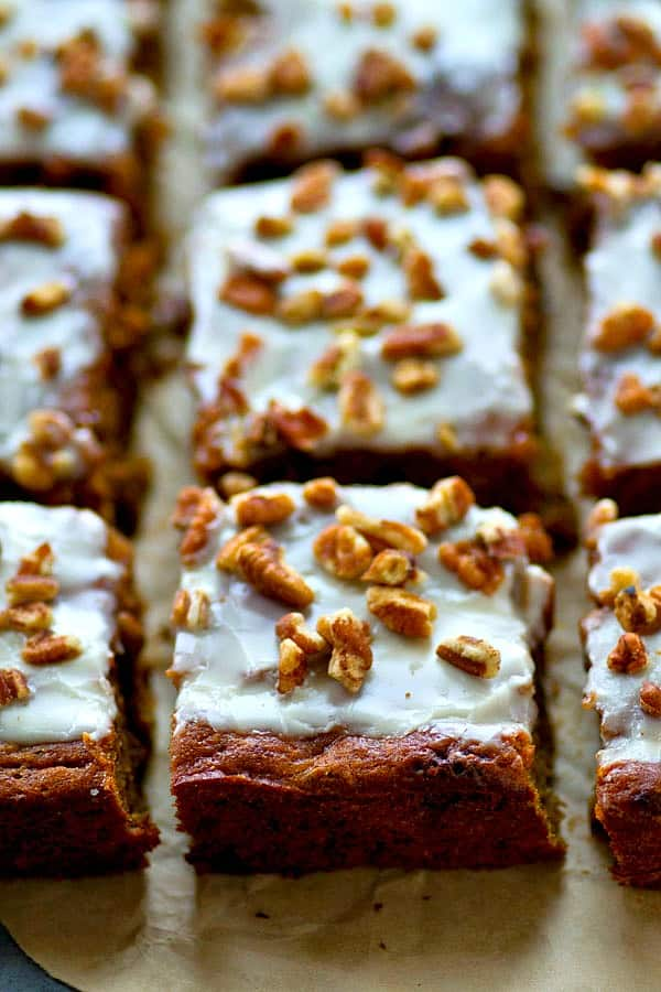 Unbelievably soft inside, loaded with pecans, and covered with tons of vanilla glaze, this lighter banana pecan snack cake is nearly impossible to stop eating once you start!