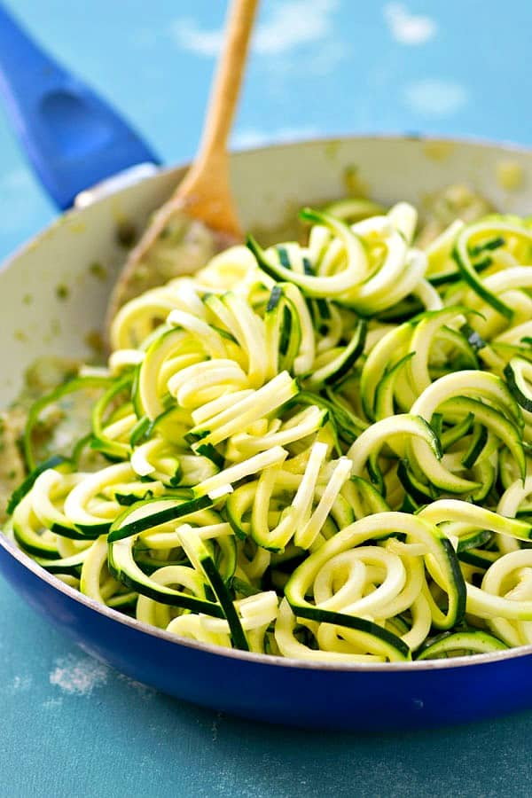 These super-creamy alfredo zucchini noodles get TONS of flavor kicked up by fresh pesto and tender chicken cubes makes it an entire carb-free meal! This one-pot dinner is the comfort food your weeknight needs!