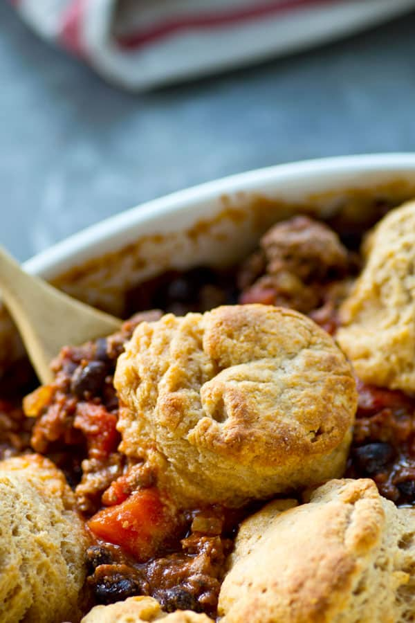 Healthier turkey chili in chili casserole form with irresistible flaky cheddar biscuits on top. This easy weeknight dinner is ready in only 30 minutes and your soon-to-be most favorite way to eat chili!